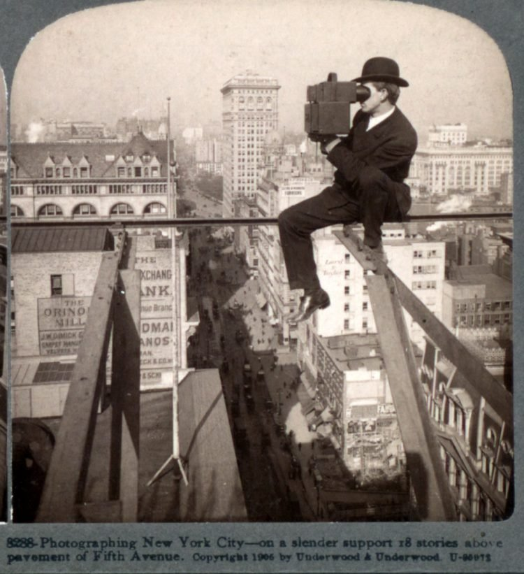 1906 Photographing New York City - on a slender support 18 stories above pavement of Fifth Avenue camera