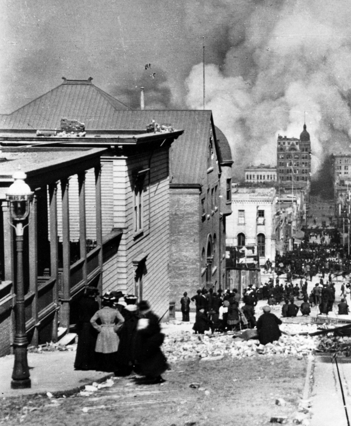 1906 earthquake - people standing on Sacramento Street watching the fire in the distance