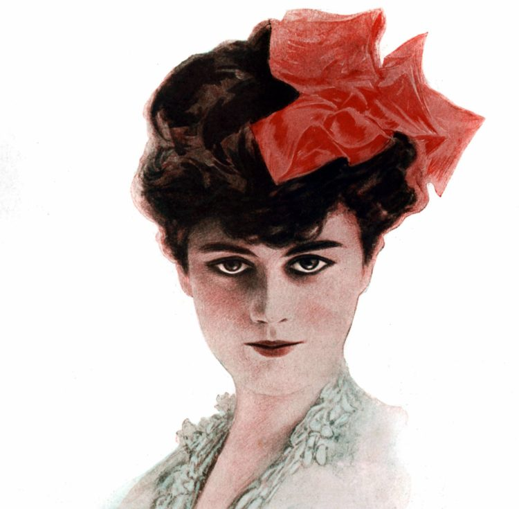 1910 Woman beauty red bow