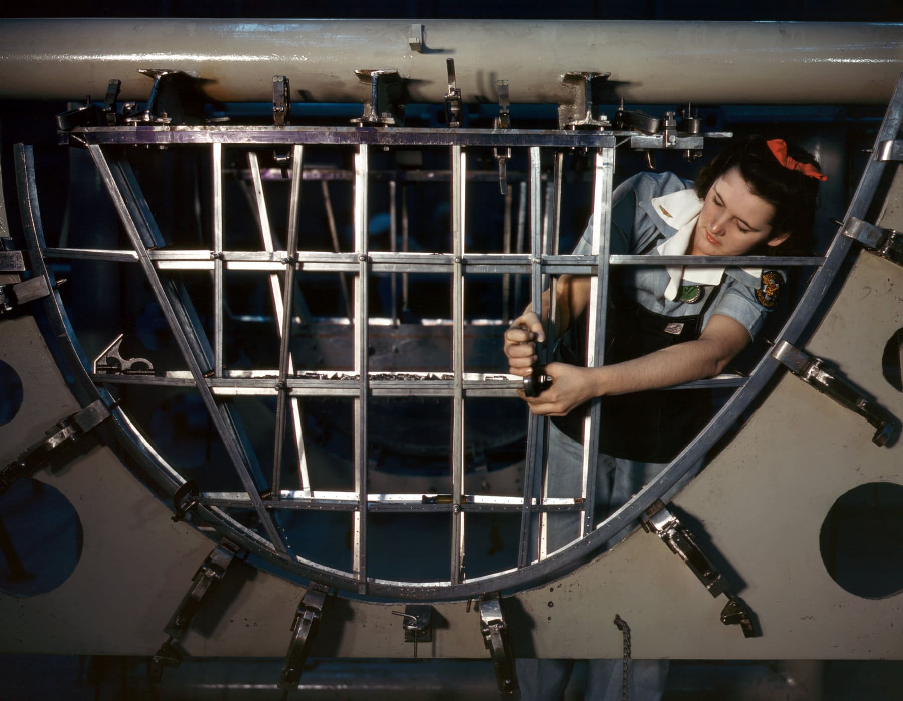 1940s woman working on a C-87 plane for WWII