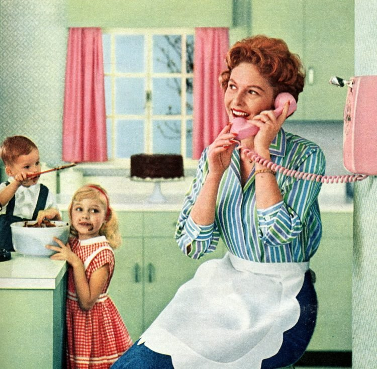 1950s housewife on a pink kitchen phone