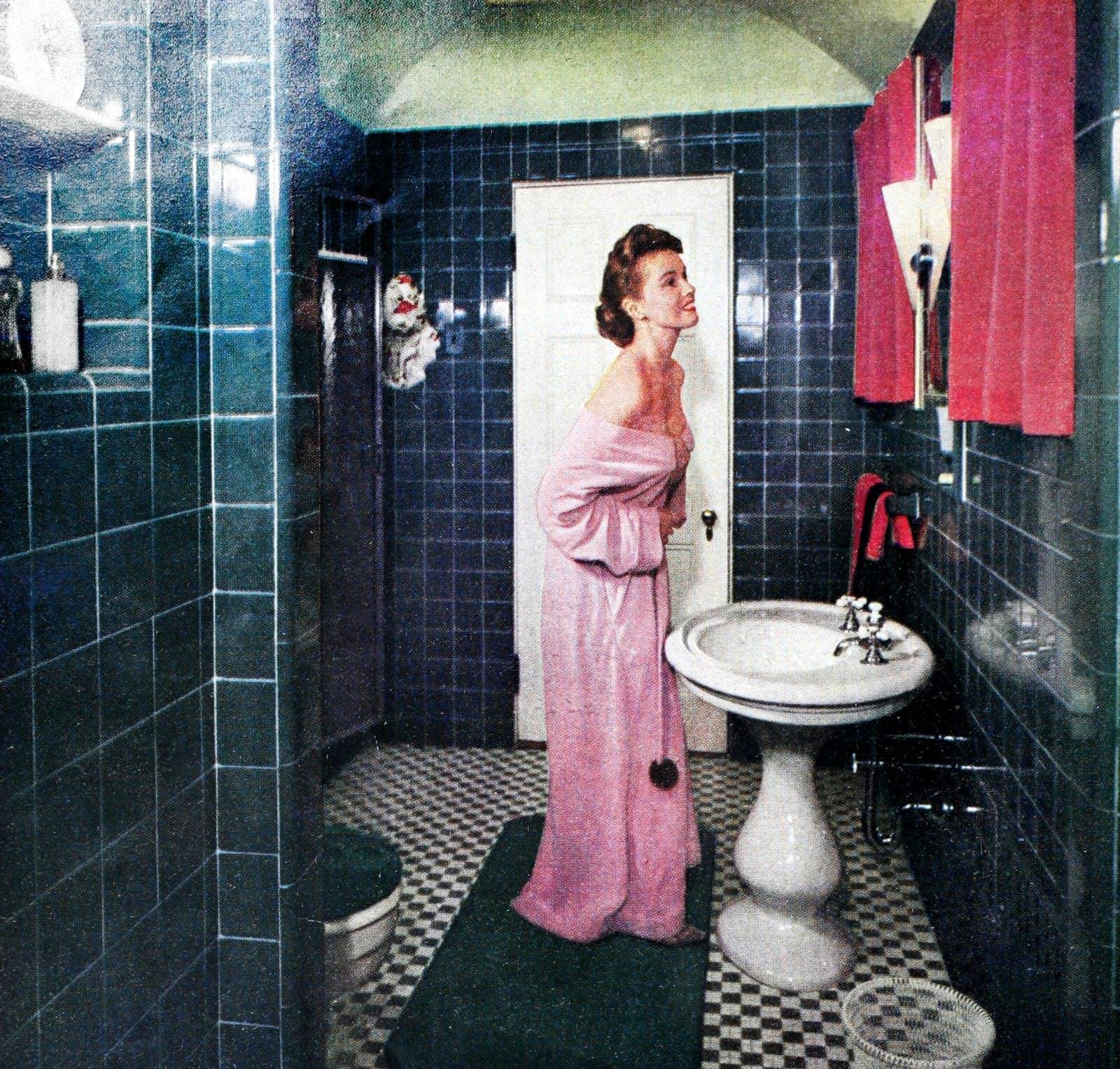 1950s woman in a teal tiled bathroom