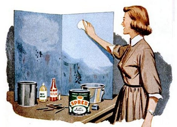 1954 - Fifties housewife cleaning the wall