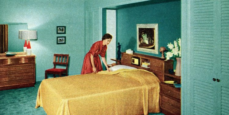 1955 - Housewife making the bed
