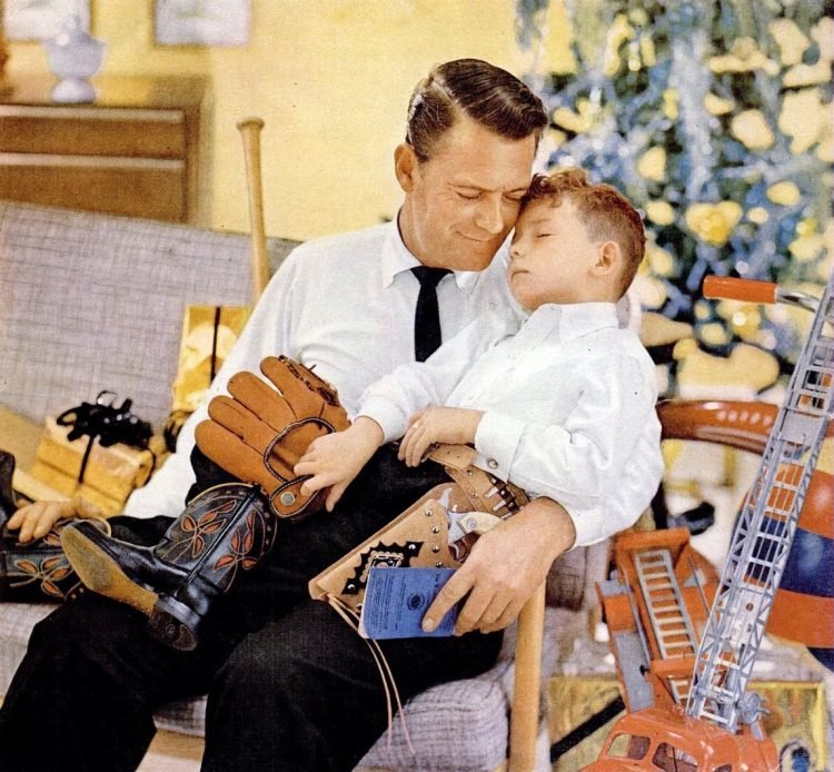 1956 Christmas father with a sleepy son