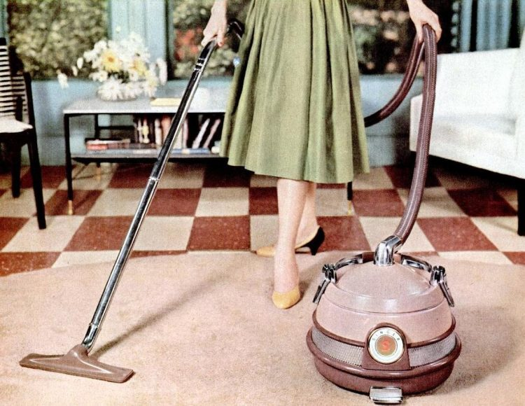 1956 Vacuuming in high heels
