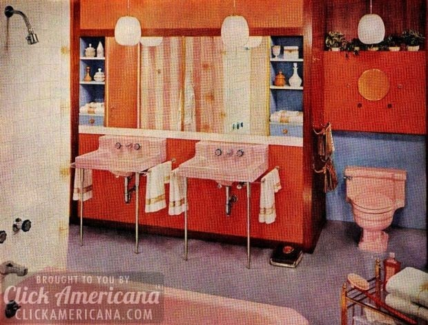 Double-pink sinks and matching tub and toilet