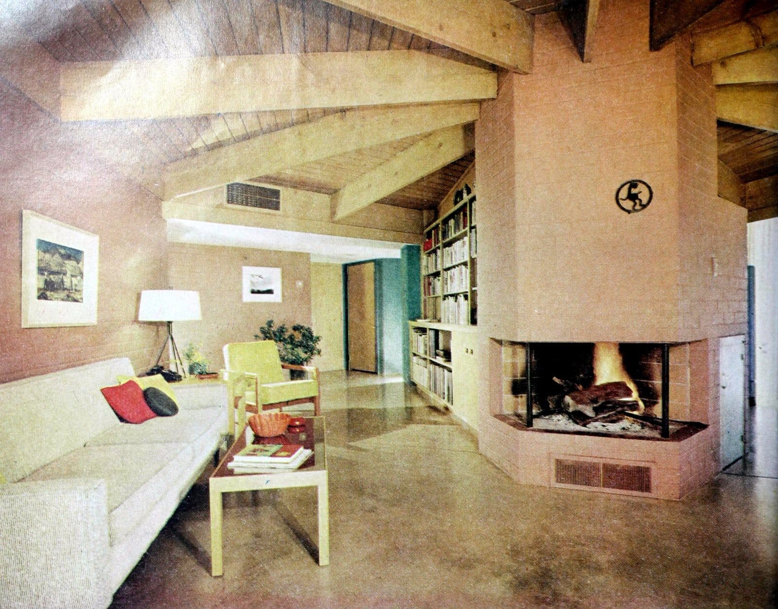 1960s living room decor - Pink brick fireplace and plain floors (1962)
