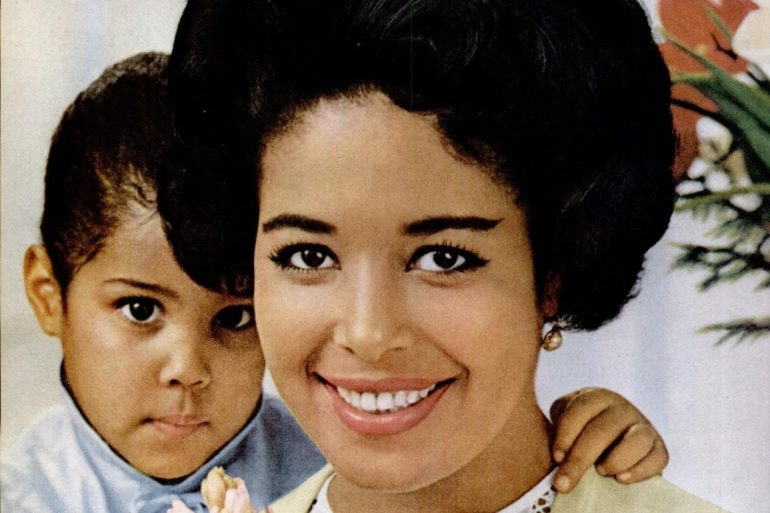 1963 Pretty mother with her toddler son - autism