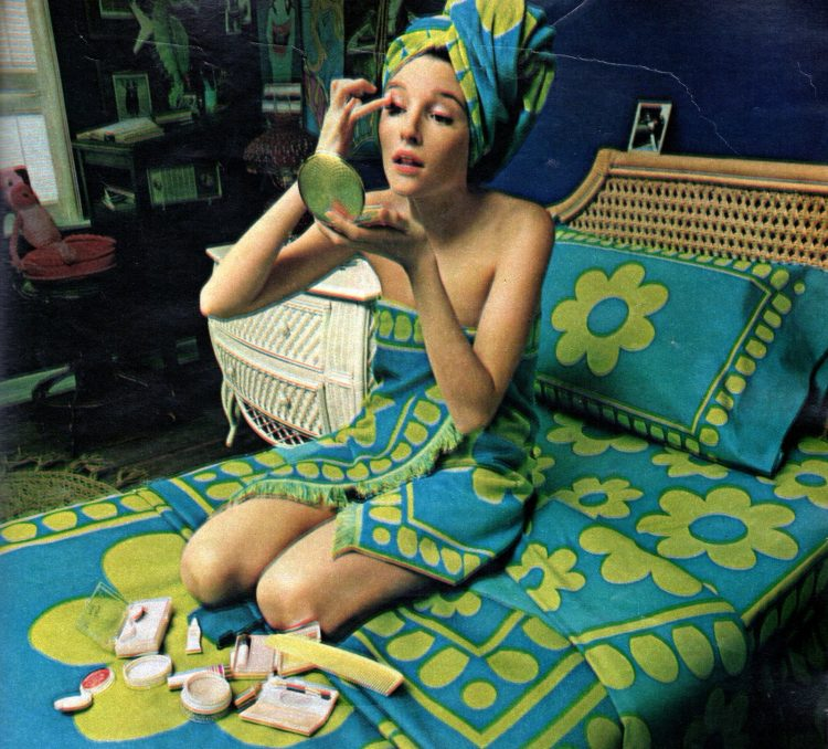 1970s girl with blue and green flowered sheets and towels