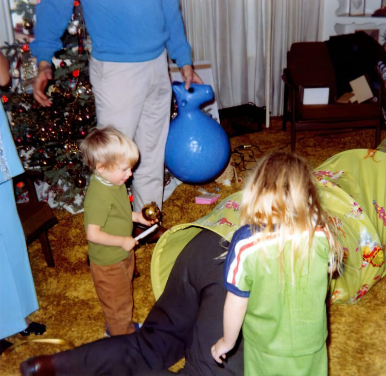 1970s kids with a green play tunnel