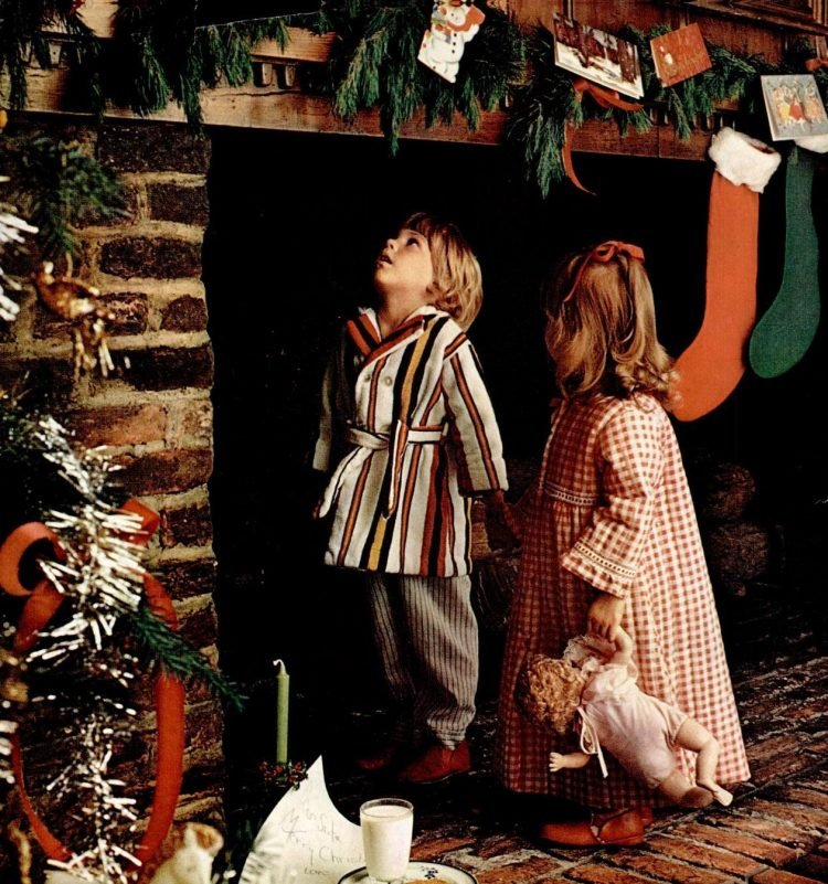 1972 Cute kids looking for Santa up the chimney