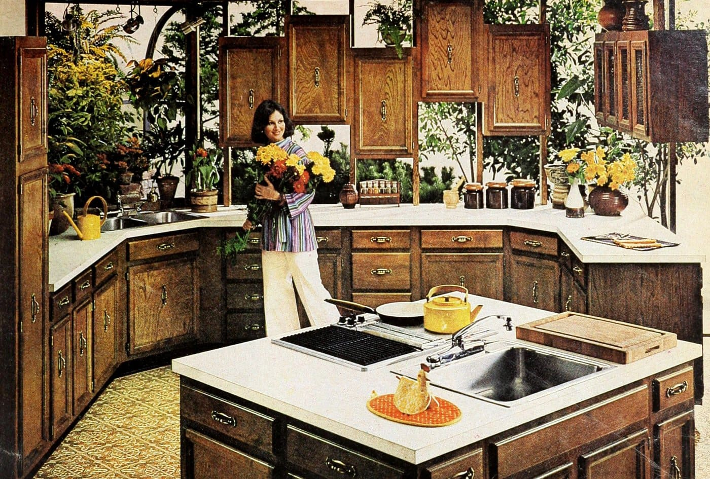 1976 kitchen design with wooden cabinetry and central island with sink and range