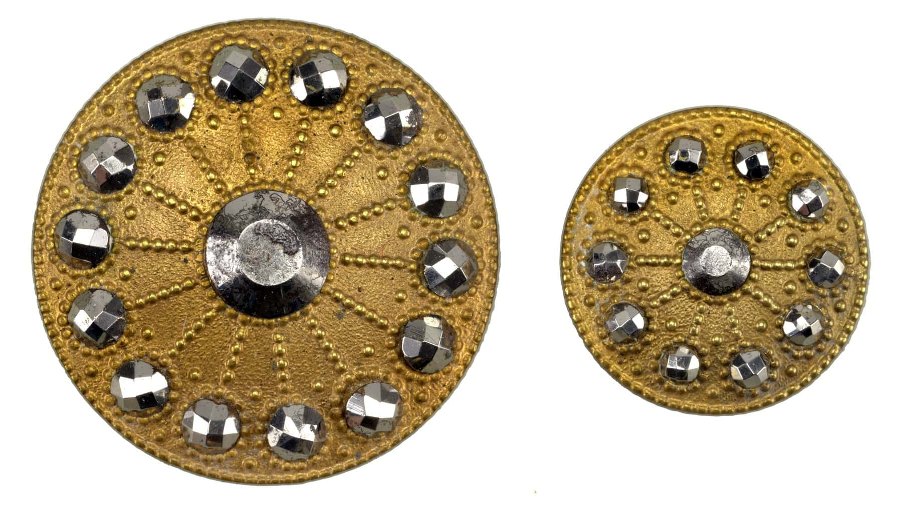 19th century brass buttons with cut steel knobs set in wheel-shaped ornaments