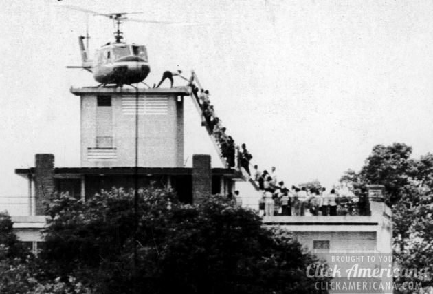 Last day of Vietnam War: Evacuees mount a staircase to board an American helicopter at 22 Gia Long, near the American Embassy in Saigon (Hubert van Es/AFP/Getty Images)