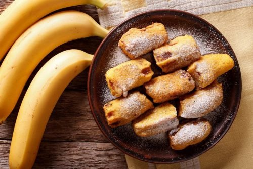 Fried bananas in batter on a plate macro. Horizont