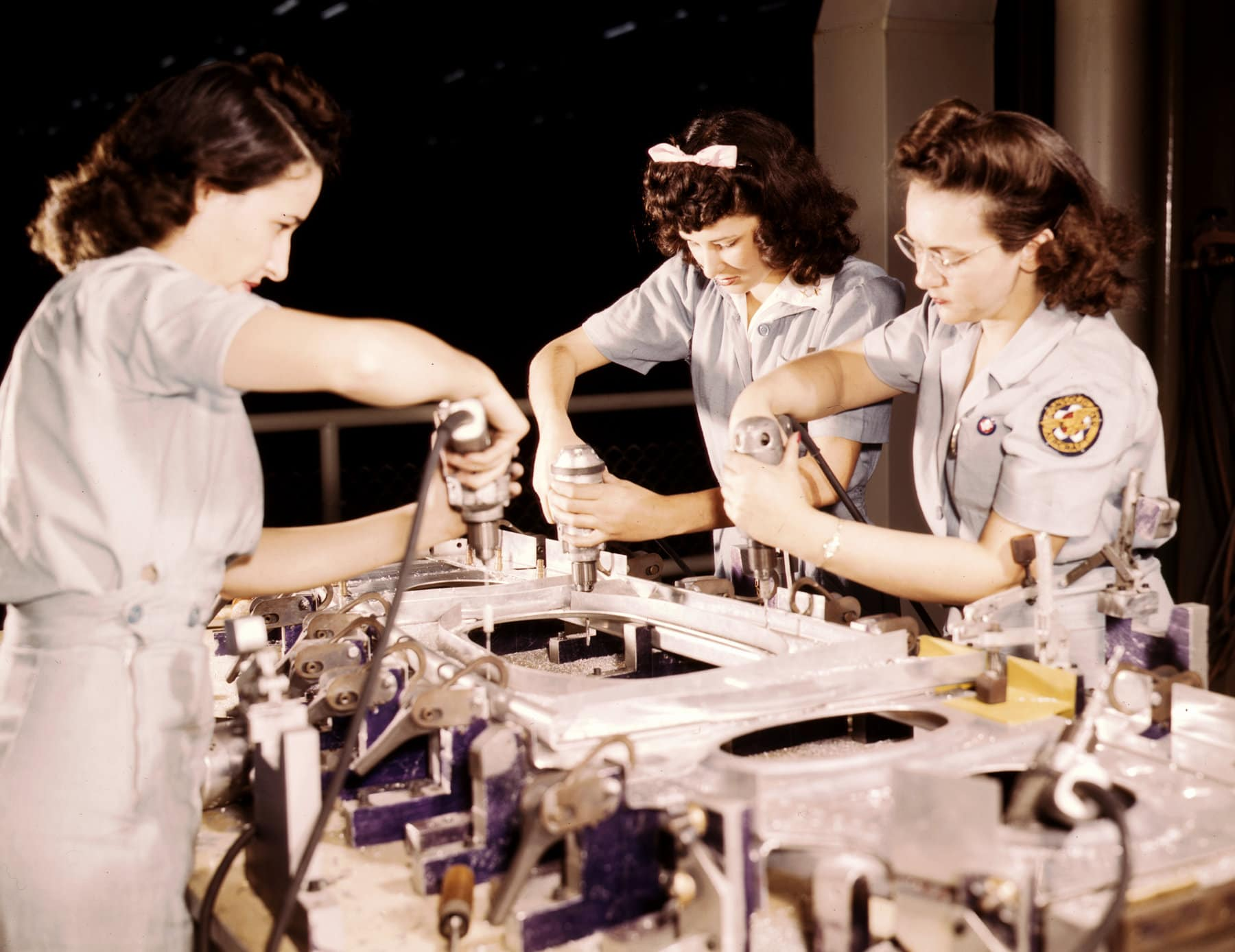 3 women drilling a wing bulkhead for a transport plane - Rosie the Riveters