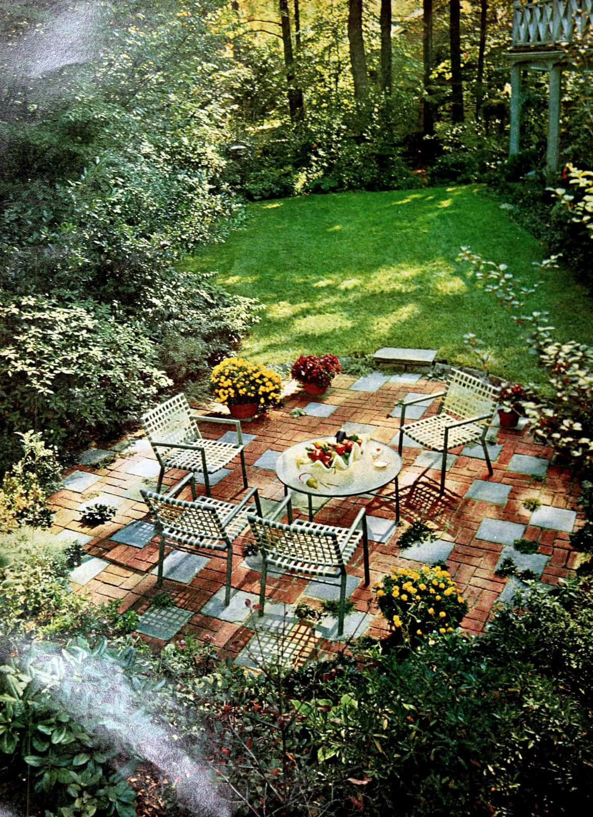 Inviting backyard with two-tone concrete decking on patio (1968)