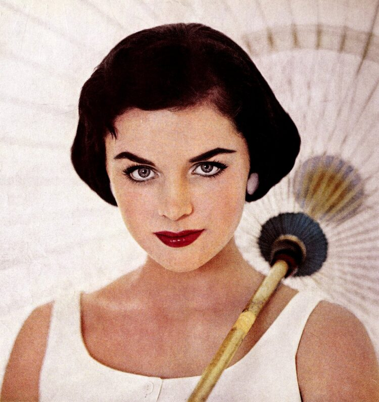 50s woman with eyebrows and makeup