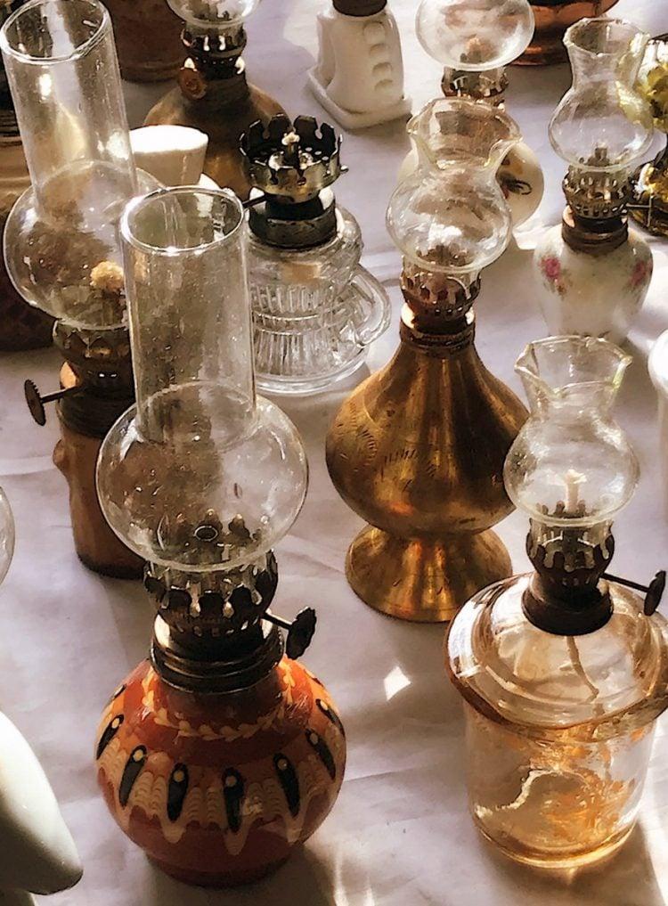 A collection of antique kerosene lamps