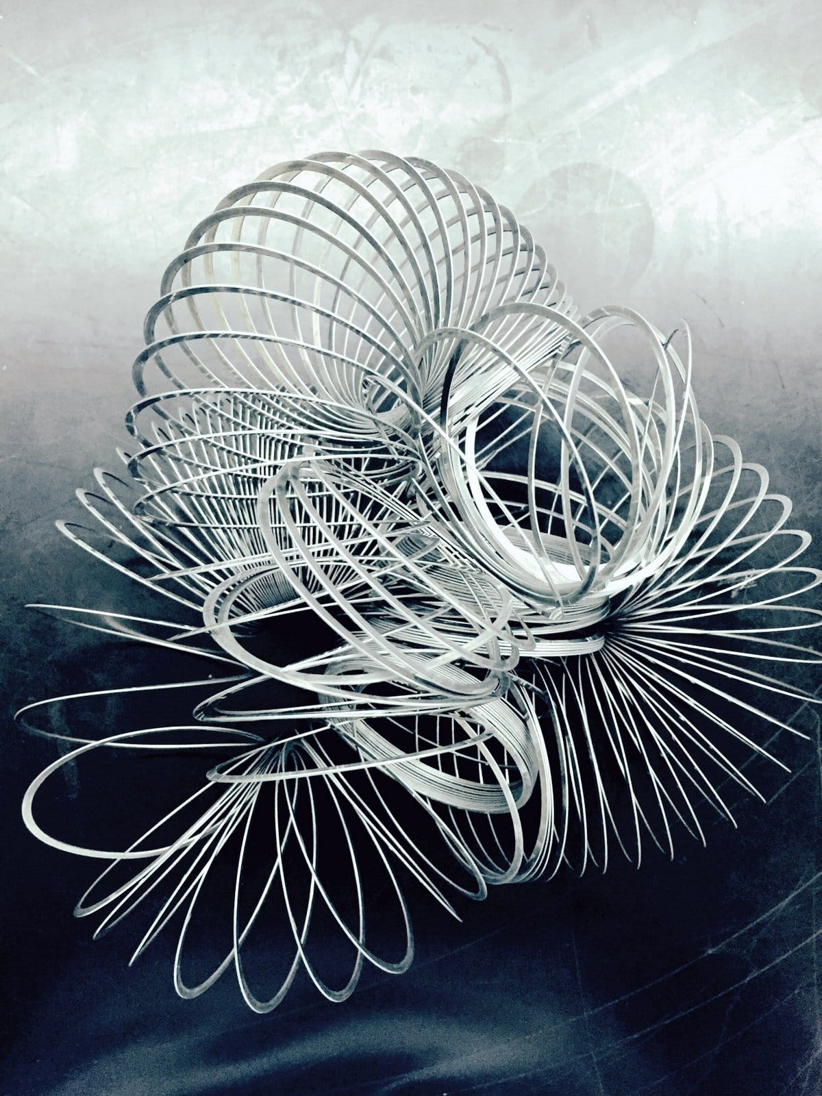 A jumbled up snarled metal Slinky toy