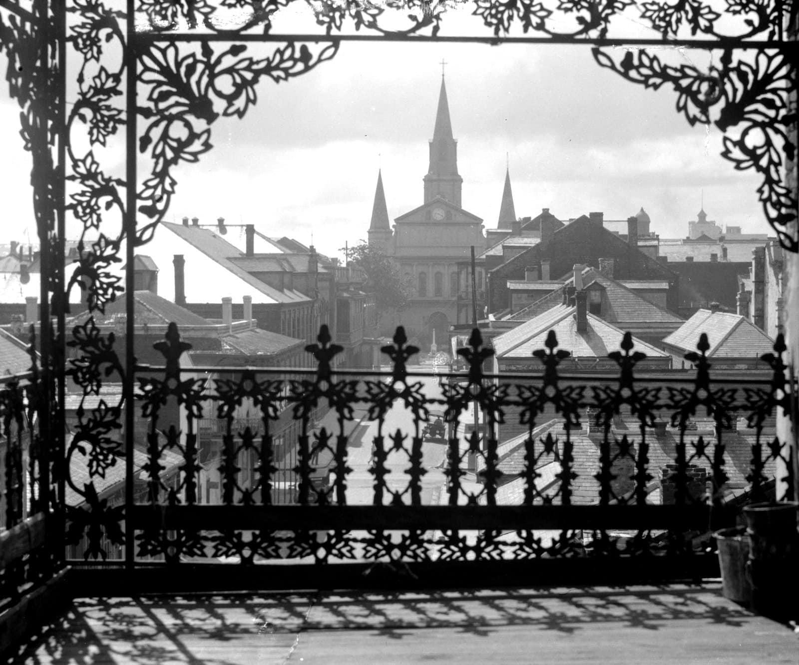 A vista through vintage iron lace, New Orleans (1920)