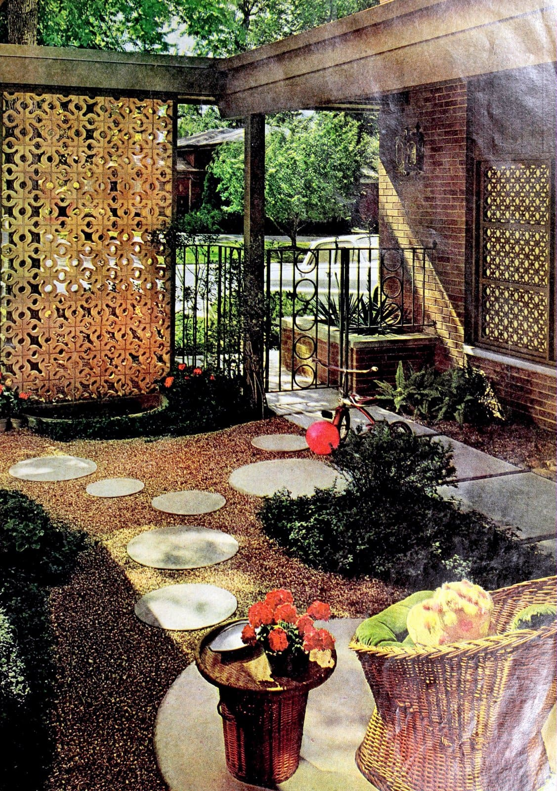 A yard by the street with pierced concrete blocks (1969)