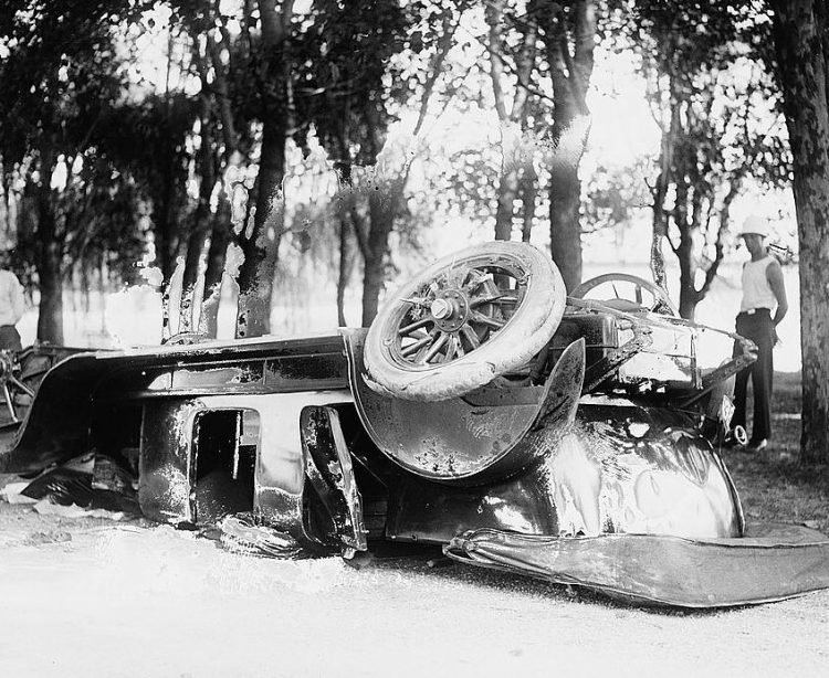 An overturned car in 1920