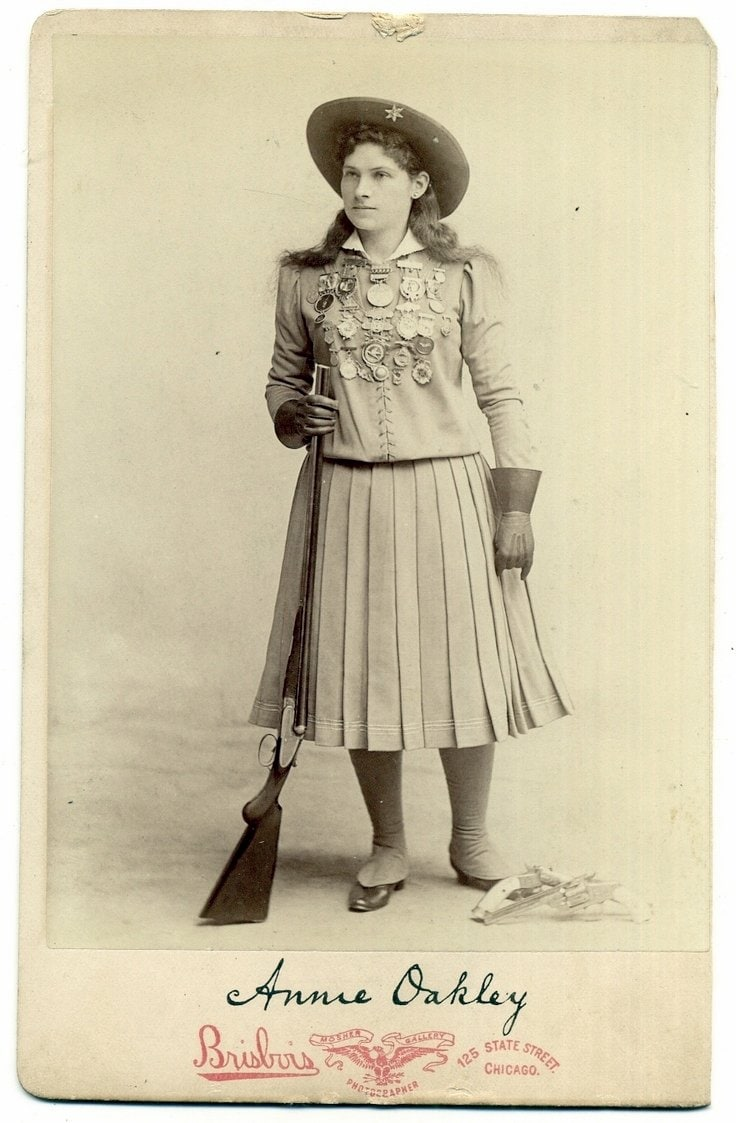 Annie Oakley card with medals