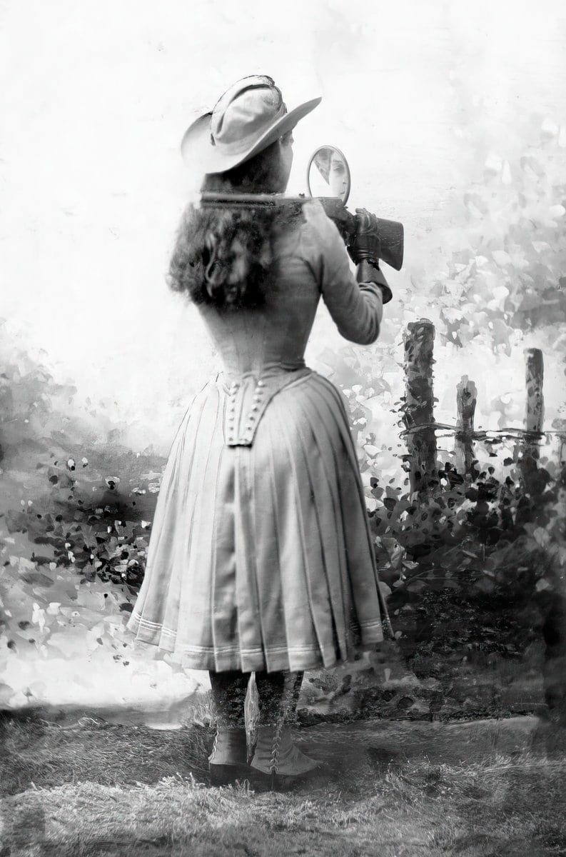 Annie Oakley shooting over her shoulder using a mirror