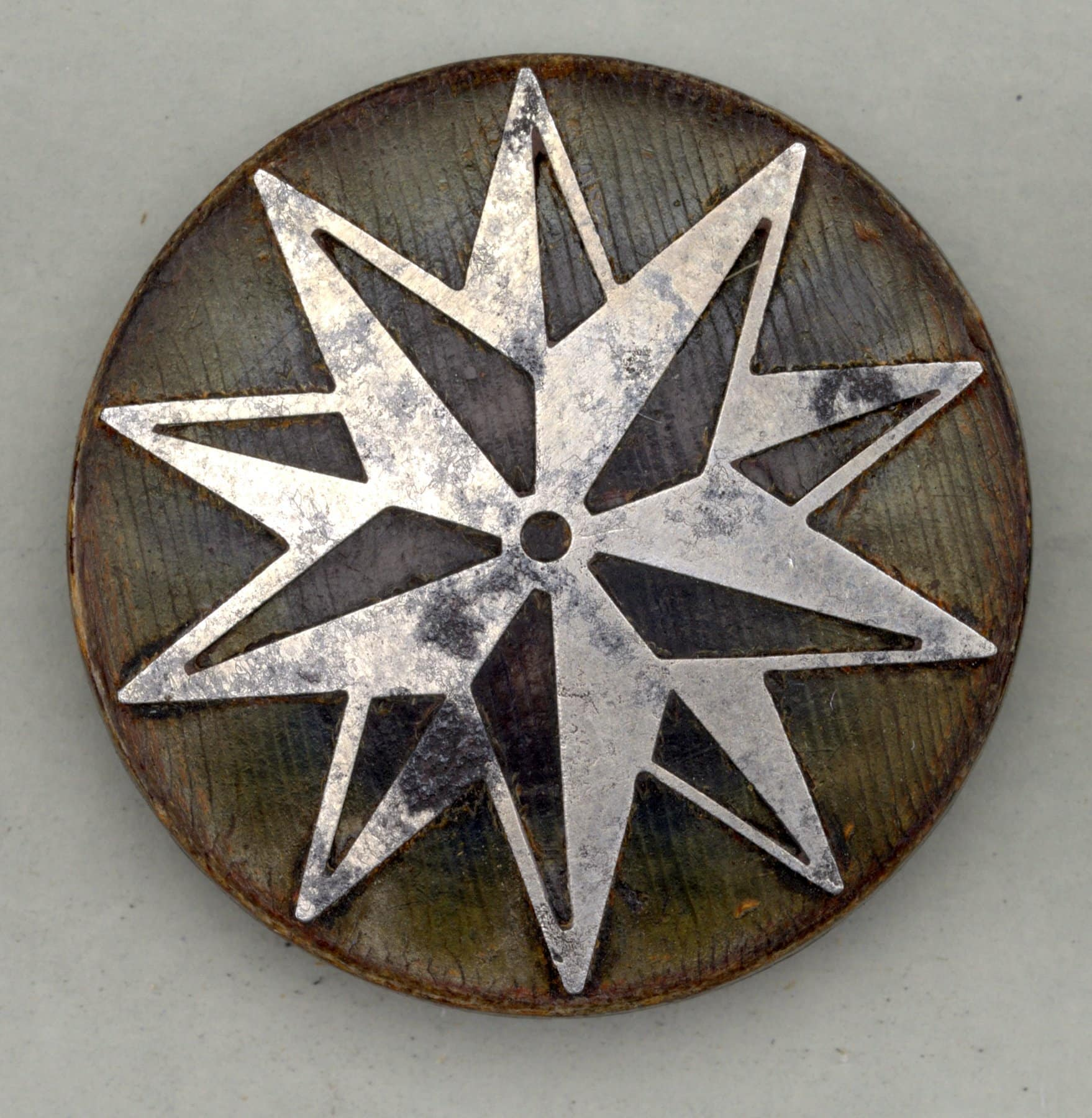 Antique 19th century flat circular wood buttons with two superimposed steel stars