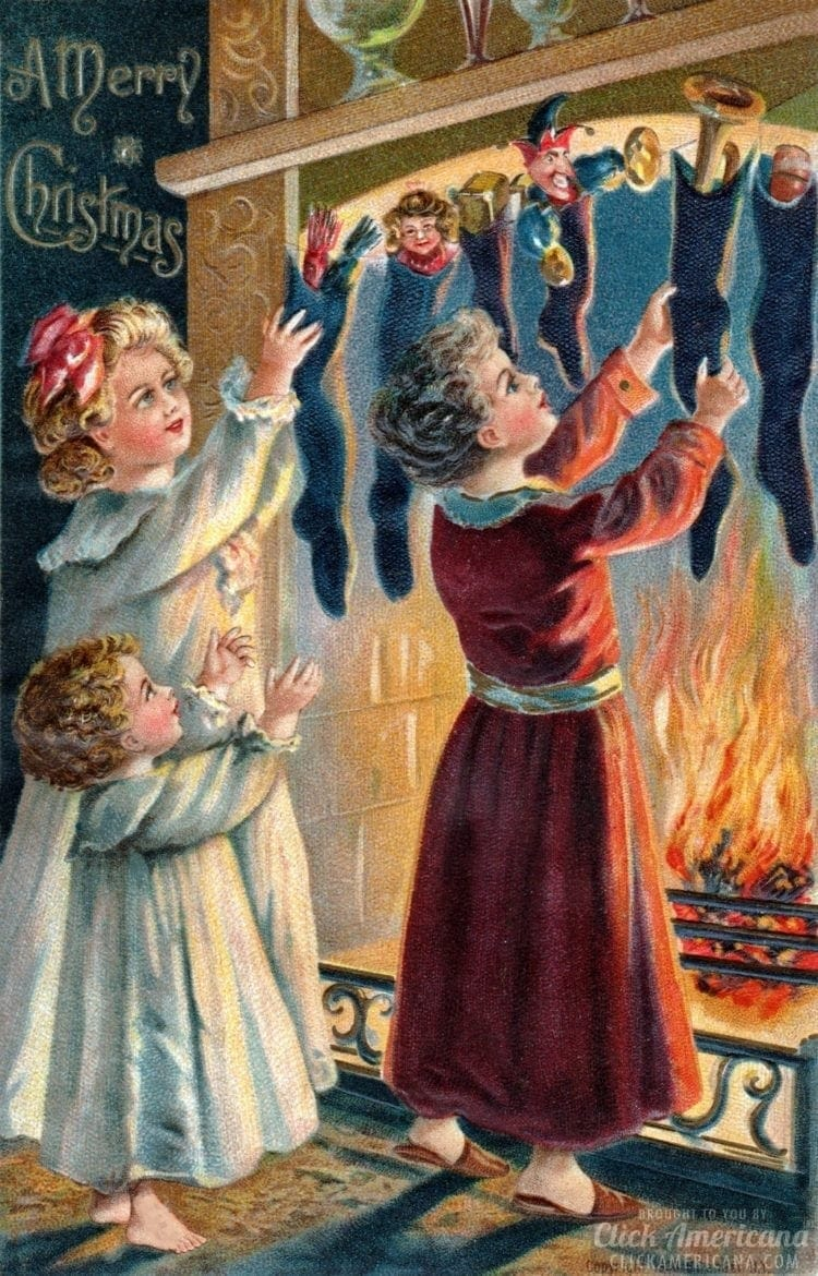 Antique Edwardian Christmas card - children hanging stockings