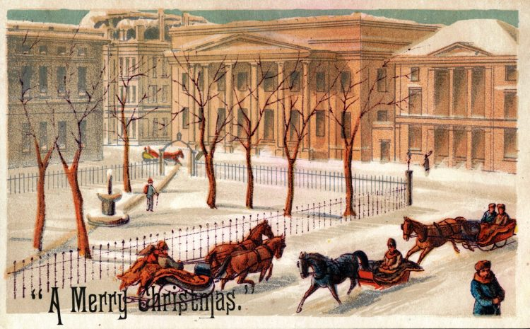 Antique Christmas postcard with a town square in the snow from the late Victorian era