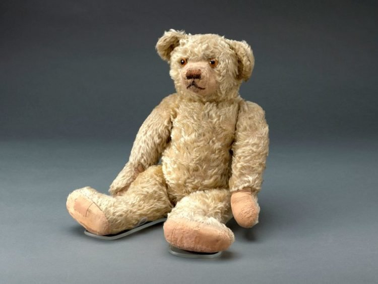 Antique Winnie the Pooh story toy