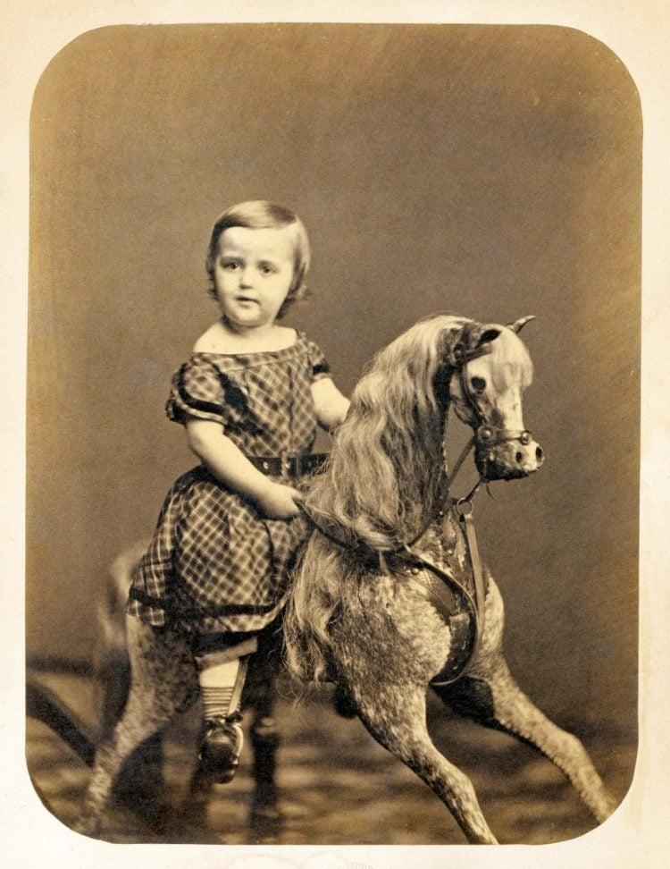 Little girl on a hobby horse