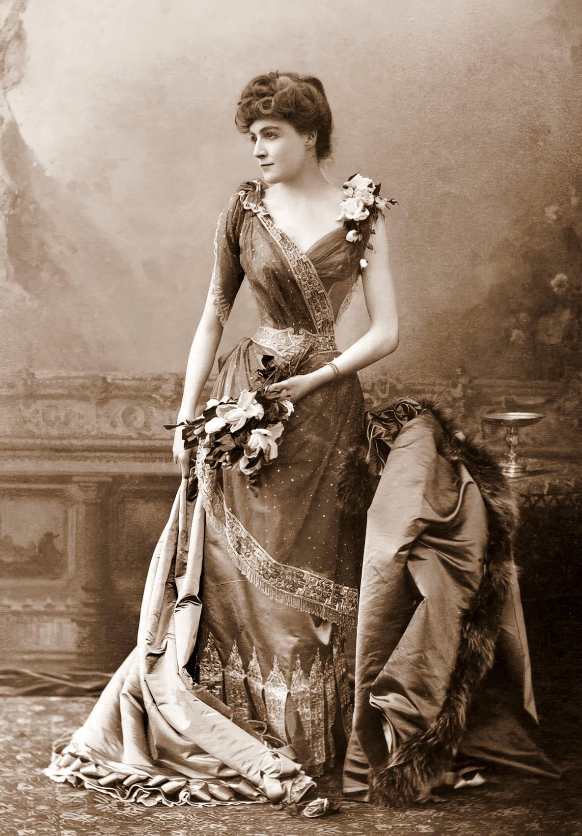 Antique photo of vintage actress in dress over corset