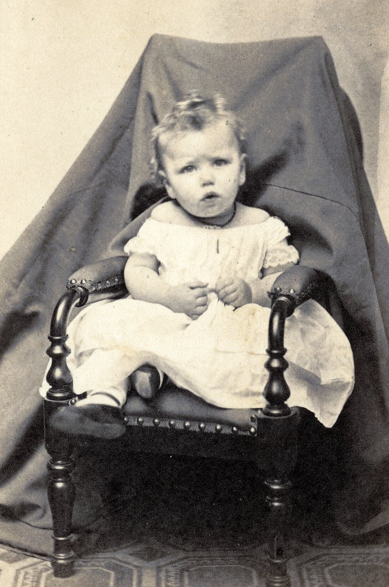 Antique portrait of a baby girl in the 1860s