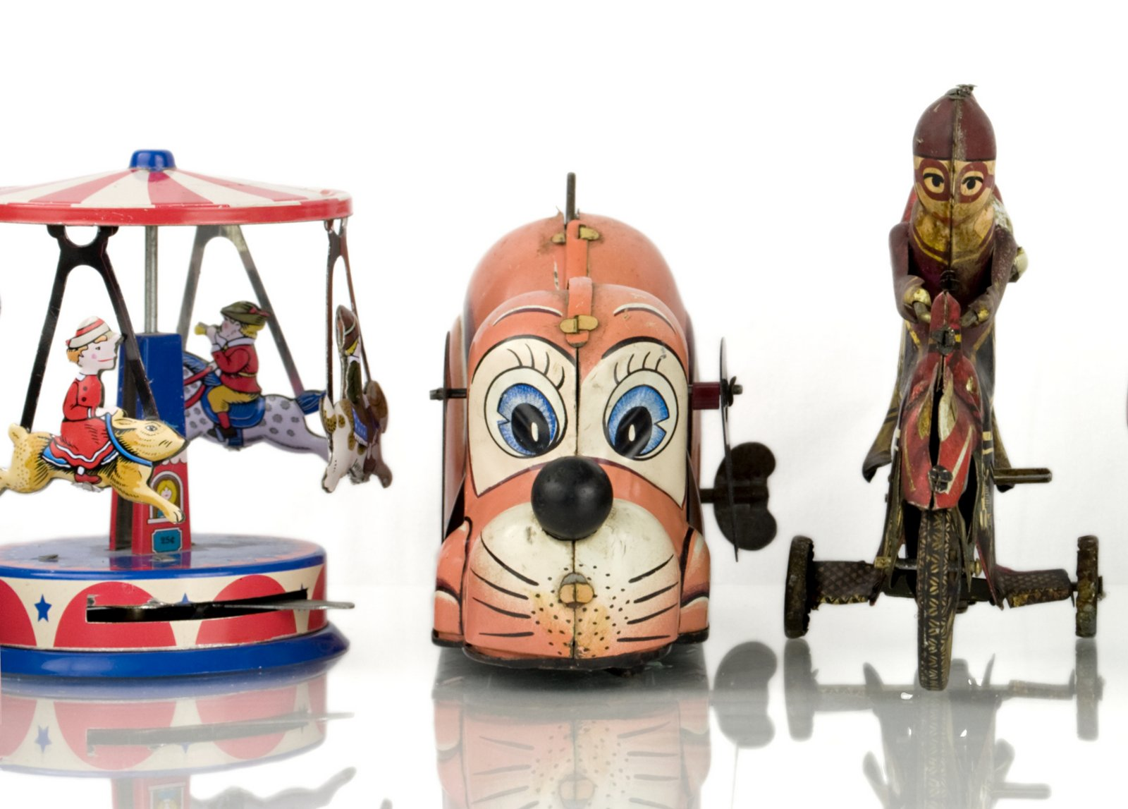 Antique tin wind-up toys