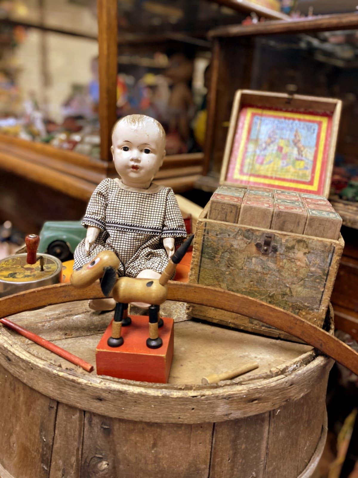 Antique toys at a vintage shop - Doll, rolling hoop, blocks and more