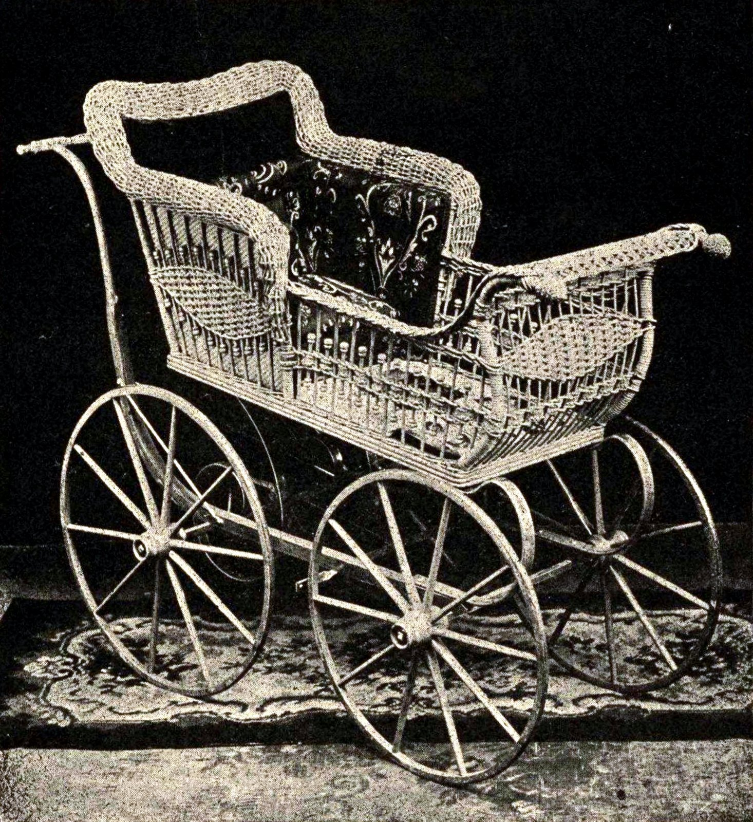 Antique wicker baby carriage from 1900