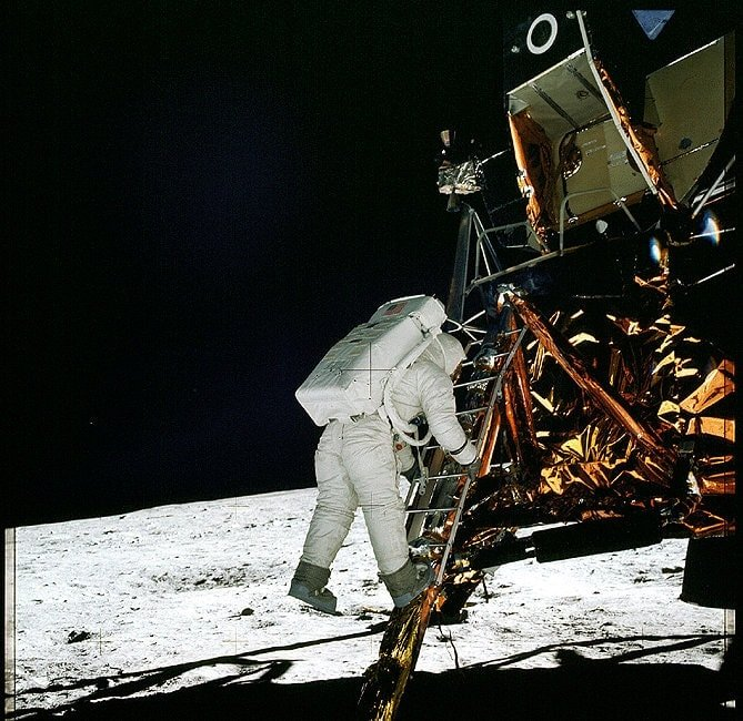 Apollo 11 Lunar Module pilot Edwin Aldrin climbs down the ladder to the Moon's surface