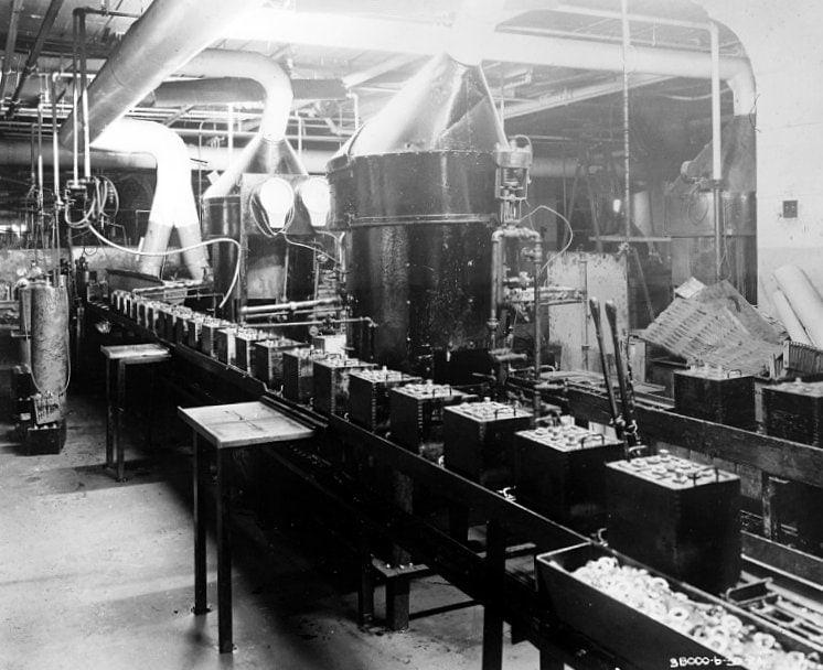 Automobile batteries on conveyor 1924