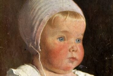 Baby from 1910s with bonnet on