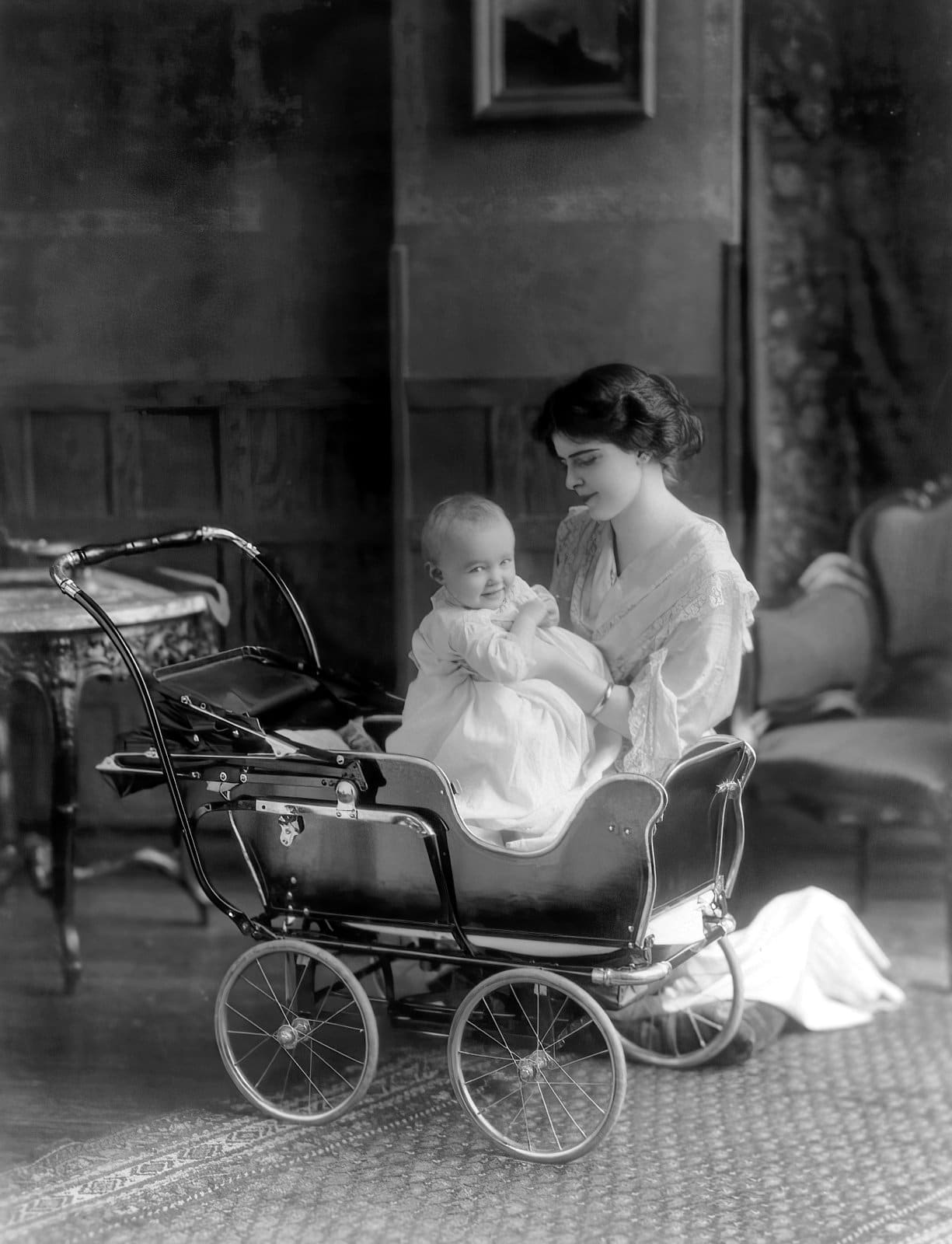 Baby in a fancy baby carriage (1913)