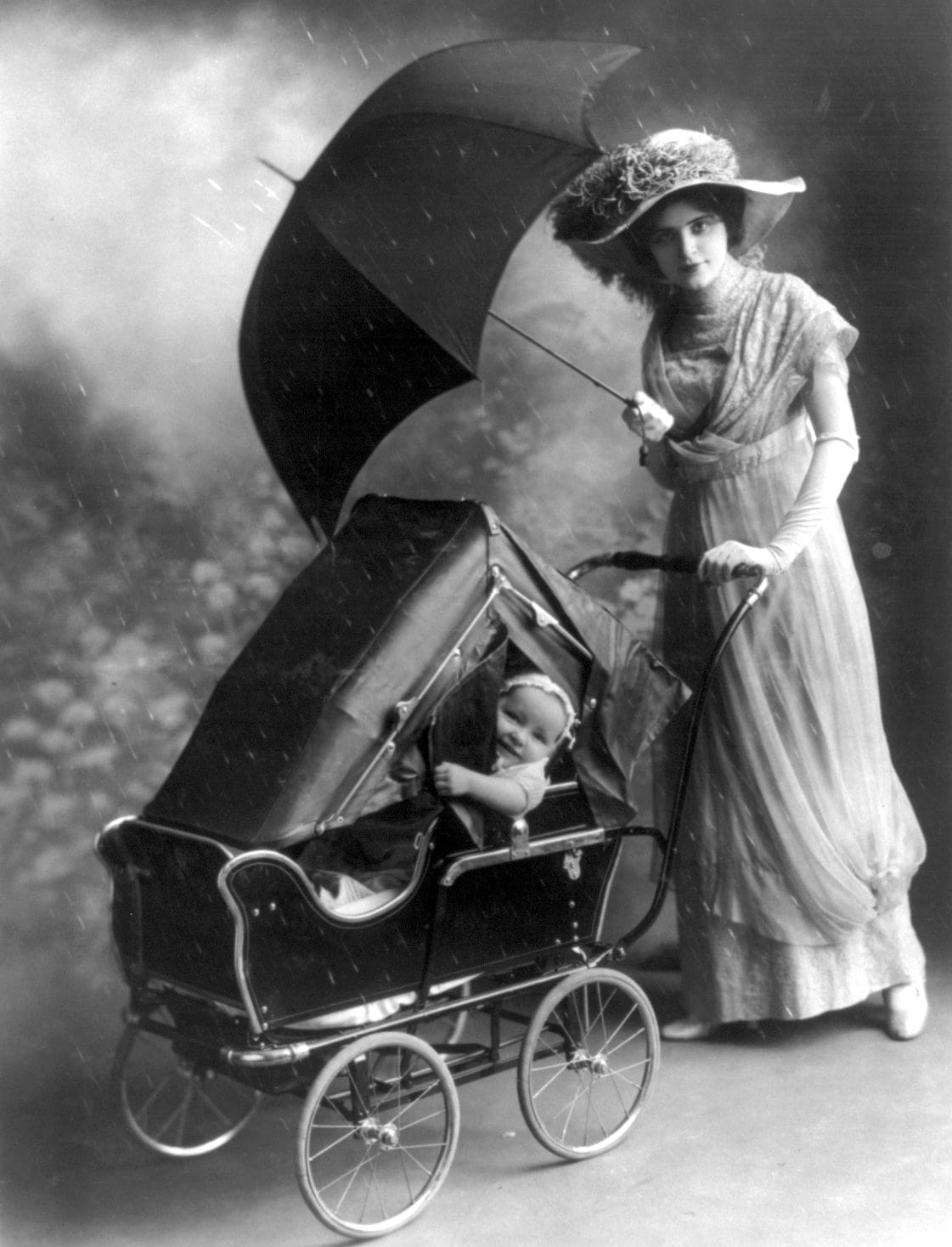 Baby pram-carriage with a cover in the rain (1913)