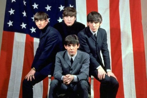 Beatles with American flag 1964