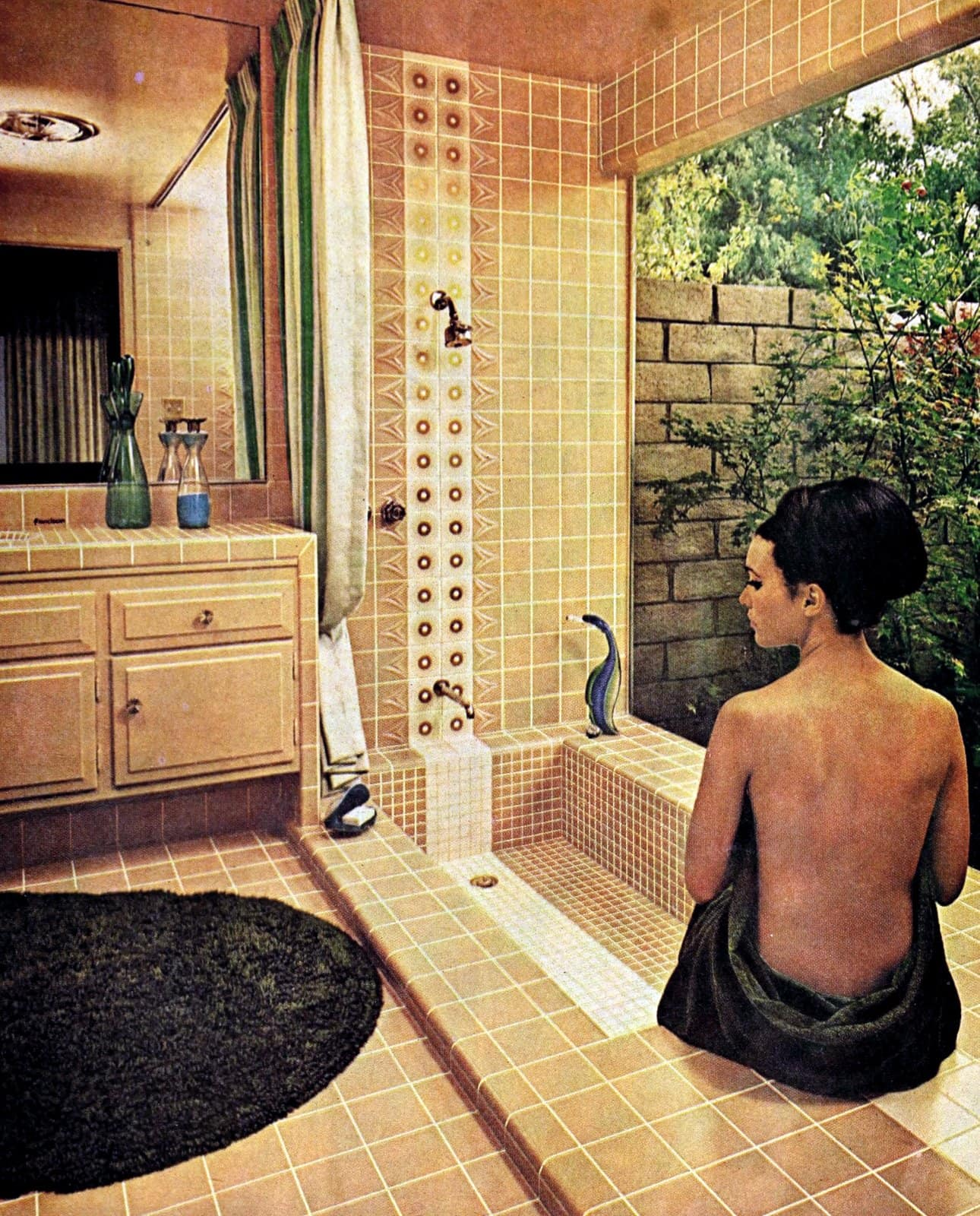 Beige-brown vintage bathroom with accent tiles and sunken tub (1964)