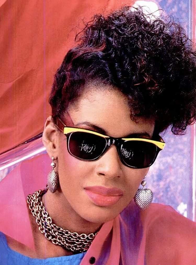 Big 80s-style hair and earrings from 1985