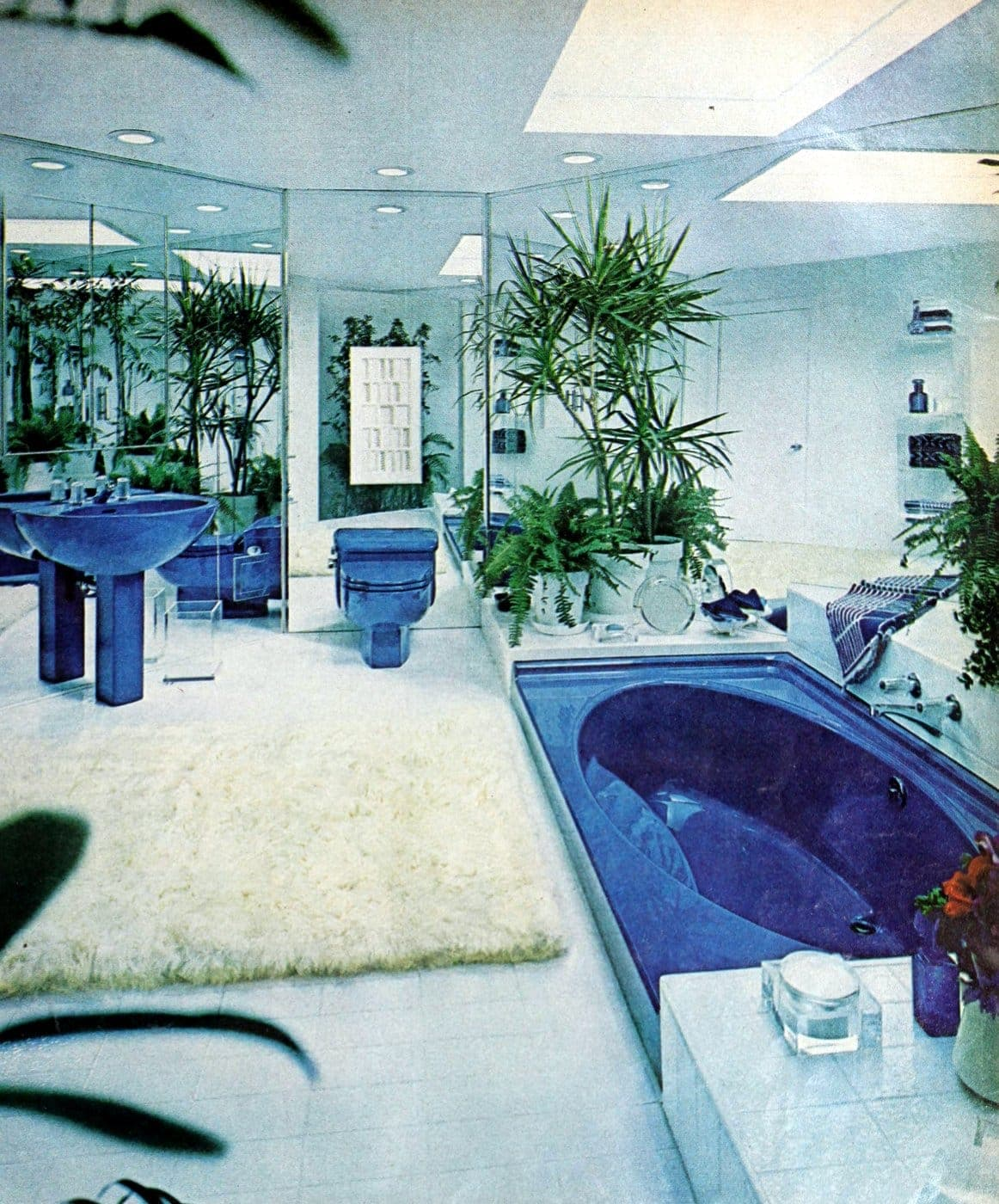 Big mirrored retro bathroom with blue tub sink and toilet - 1974