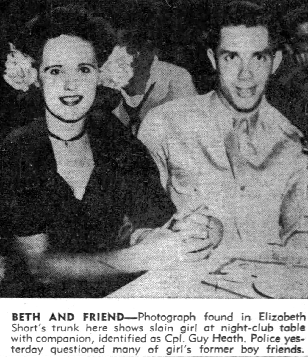 Black Dahlia and a date at a night club table